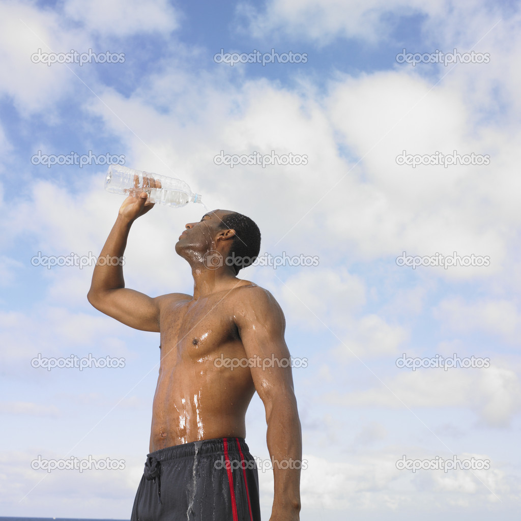 African man pouring water over head