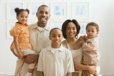 Portrait of African family indoors