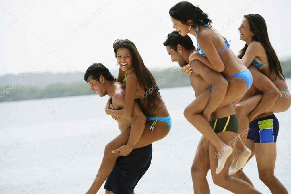 South American couples playing at beach
