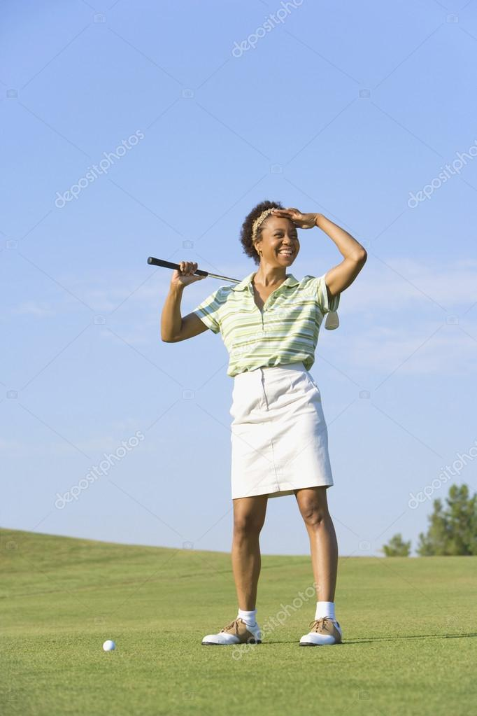 Portrait of African woman on golf course