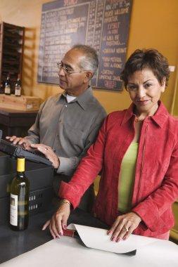 Couple selling wine