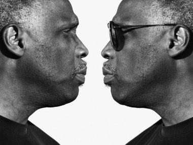 Two identical men looking face to face