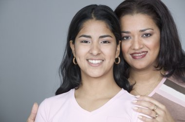 Portrait of mother with teenage daughter