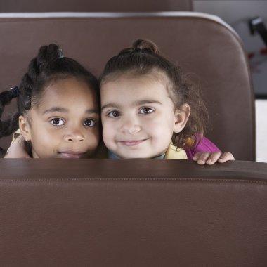 Portrait of girls on school bus