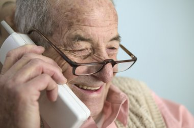 Elderly man talking on cell phone
