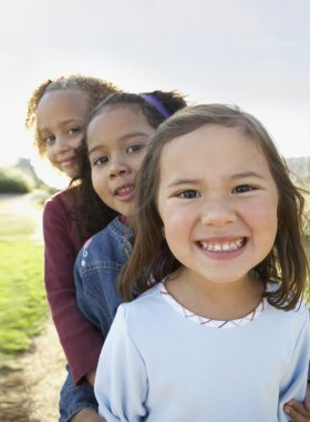Portrait of three young girls smiling