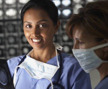 Portrait of two female doctors in scrubs