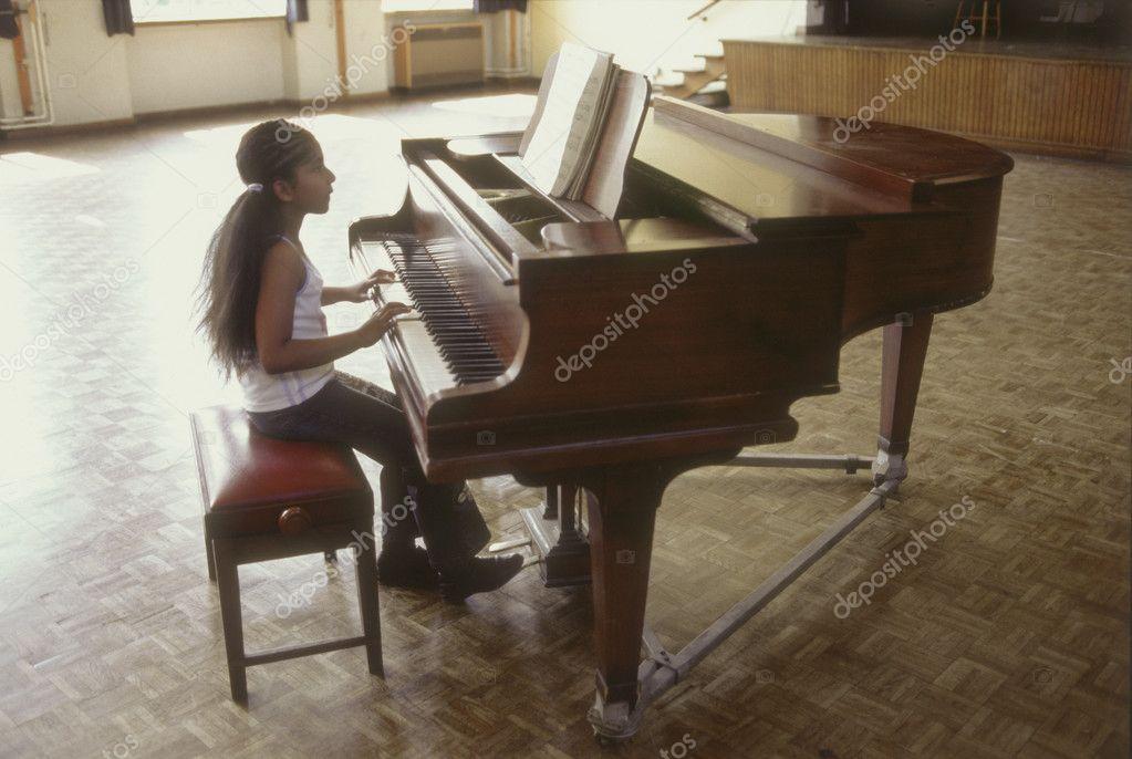 Profile of girl playing piano