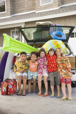 Children and beach gear in packed car