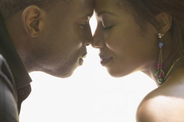 African couple touching noses