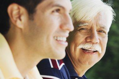 Senior Hispanic man with adult son