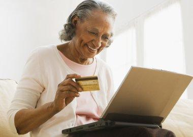 Senior African woman online shopping