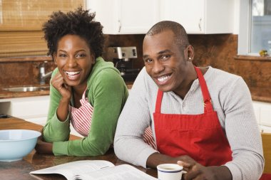 African American couple with cookbook
