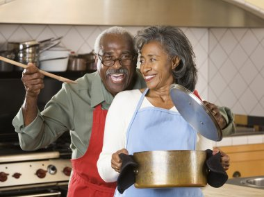Senior African couple cooking