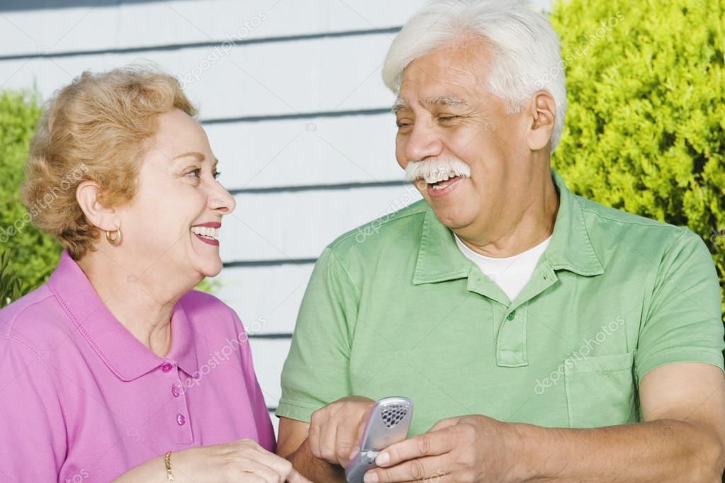 Senior Hispanic couple with cell phone