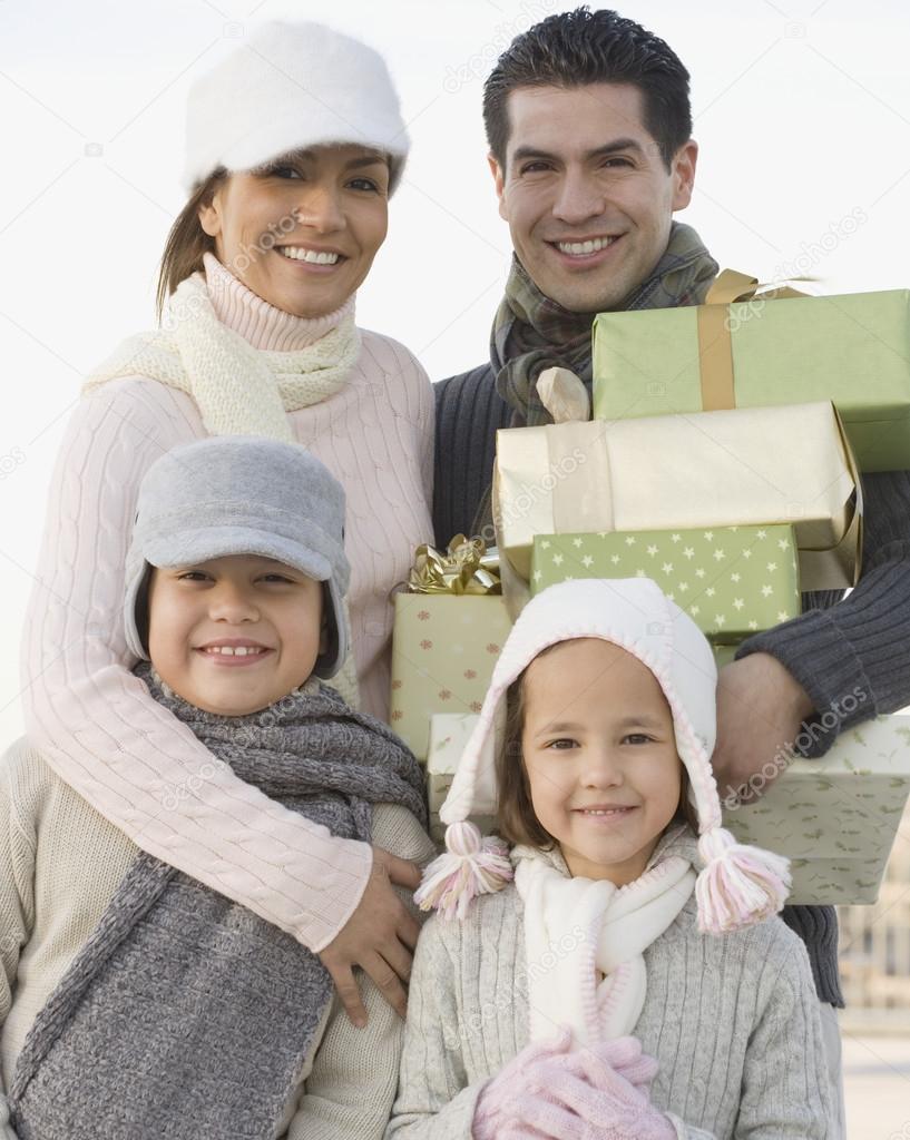 Portrait of Hispanic family on Christmas