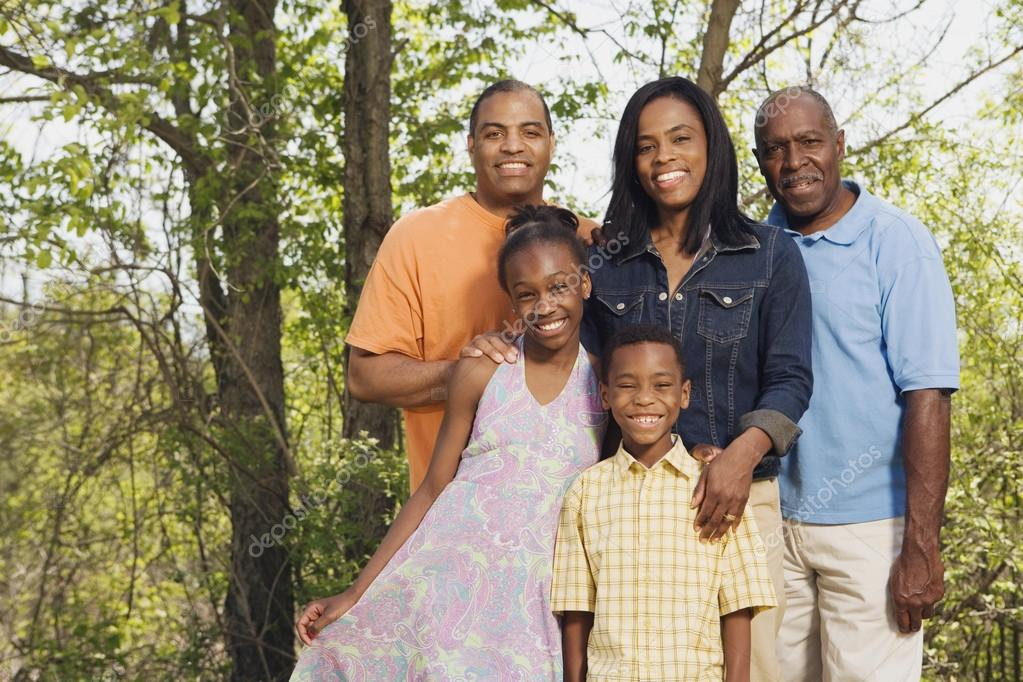 Multi-generational African family smiling in park