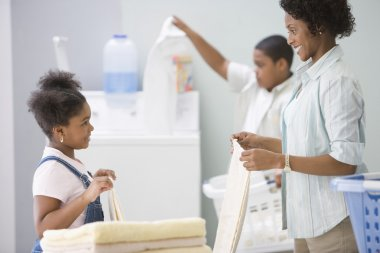 African American mother and children doing laundry