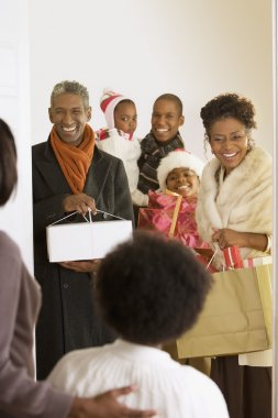 African family arriving with Christmas gifts