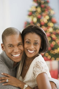 Mixed Race couple hugging on Christmas