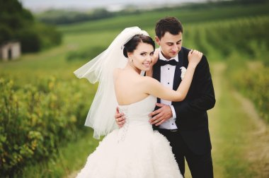 outdoor portrait of wedding couple