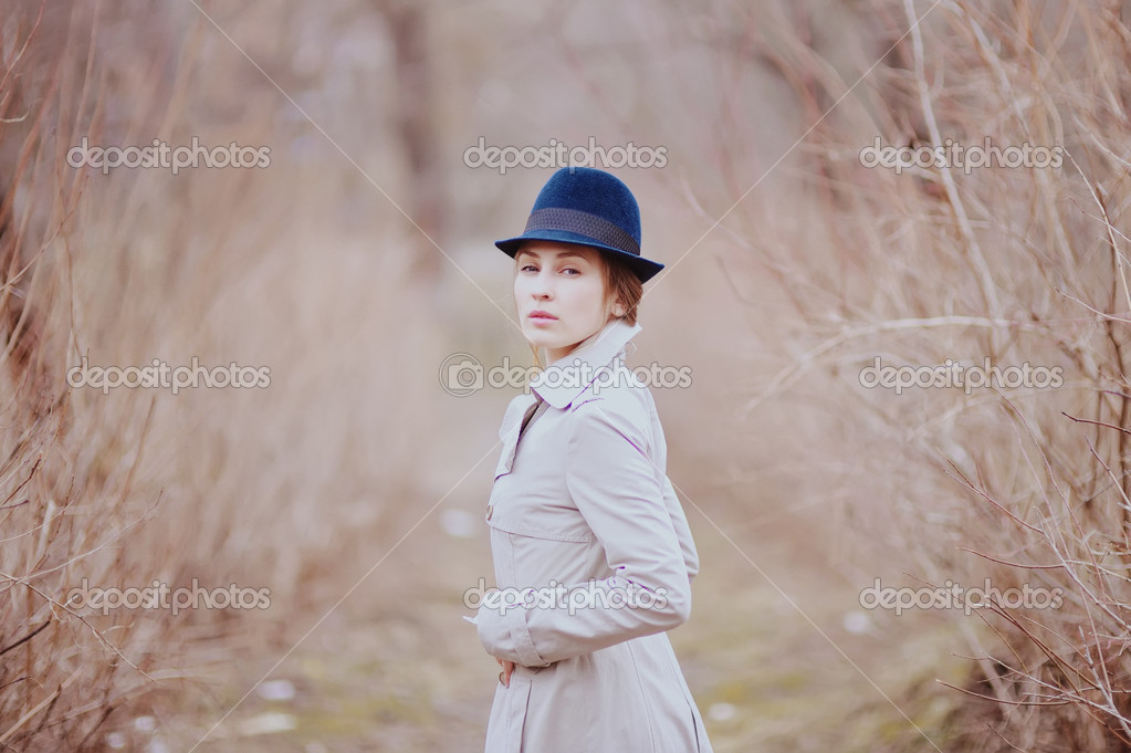 Young curly hair woman in spring garden — Stock Photo
