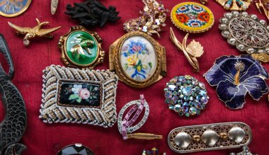 Jewelry background. Vintage brooches at flea market in Paris.