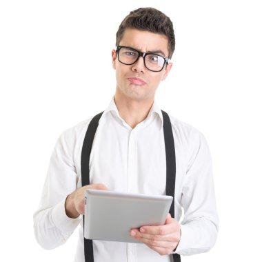 Weird facial expression businessman using digital tablet