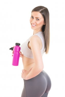 Attractive fitness girl refreshing after training