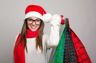 Excited young woman shopping for Christmas