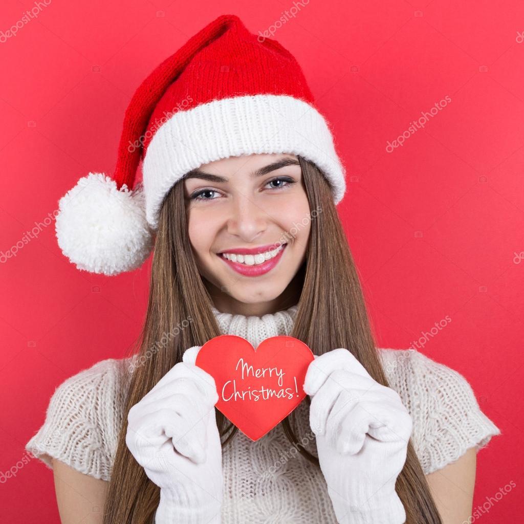 glückliche Teen Mädchen mit Hut Ergebnis message Frohe Weihnachten ...