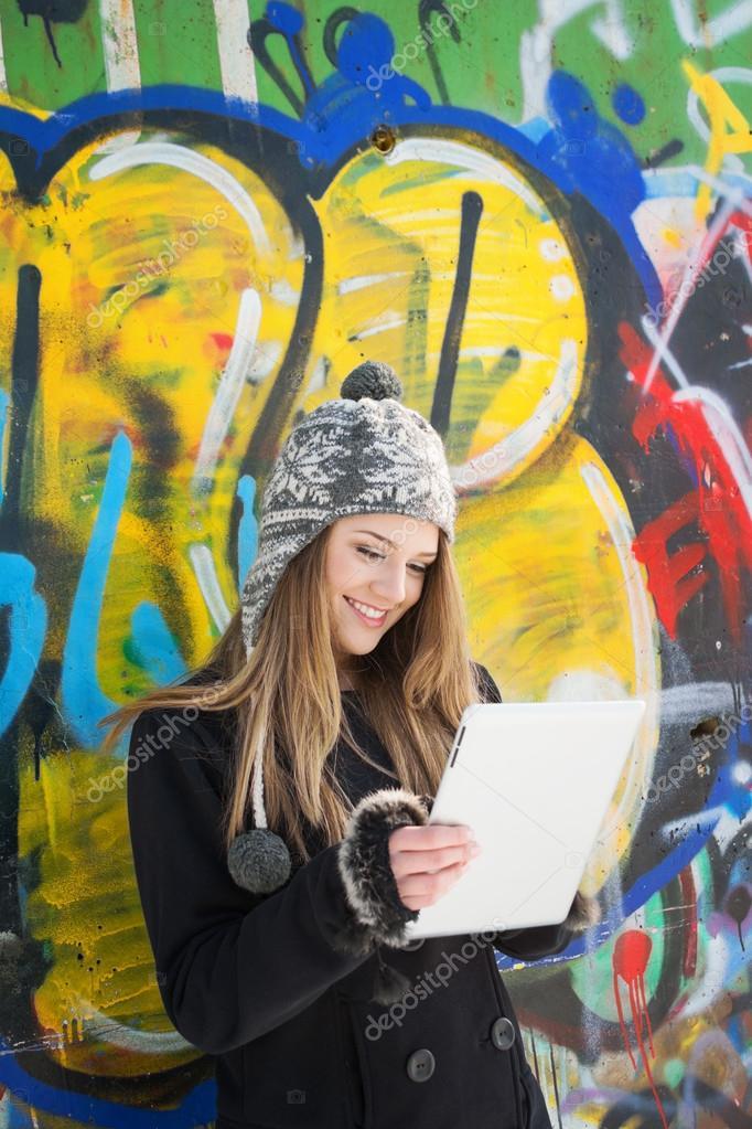 Smiling teenage girl with digital tablet