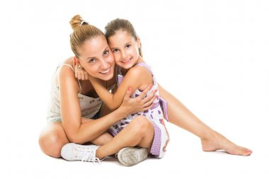 Young mother and daughter hugging and smiling