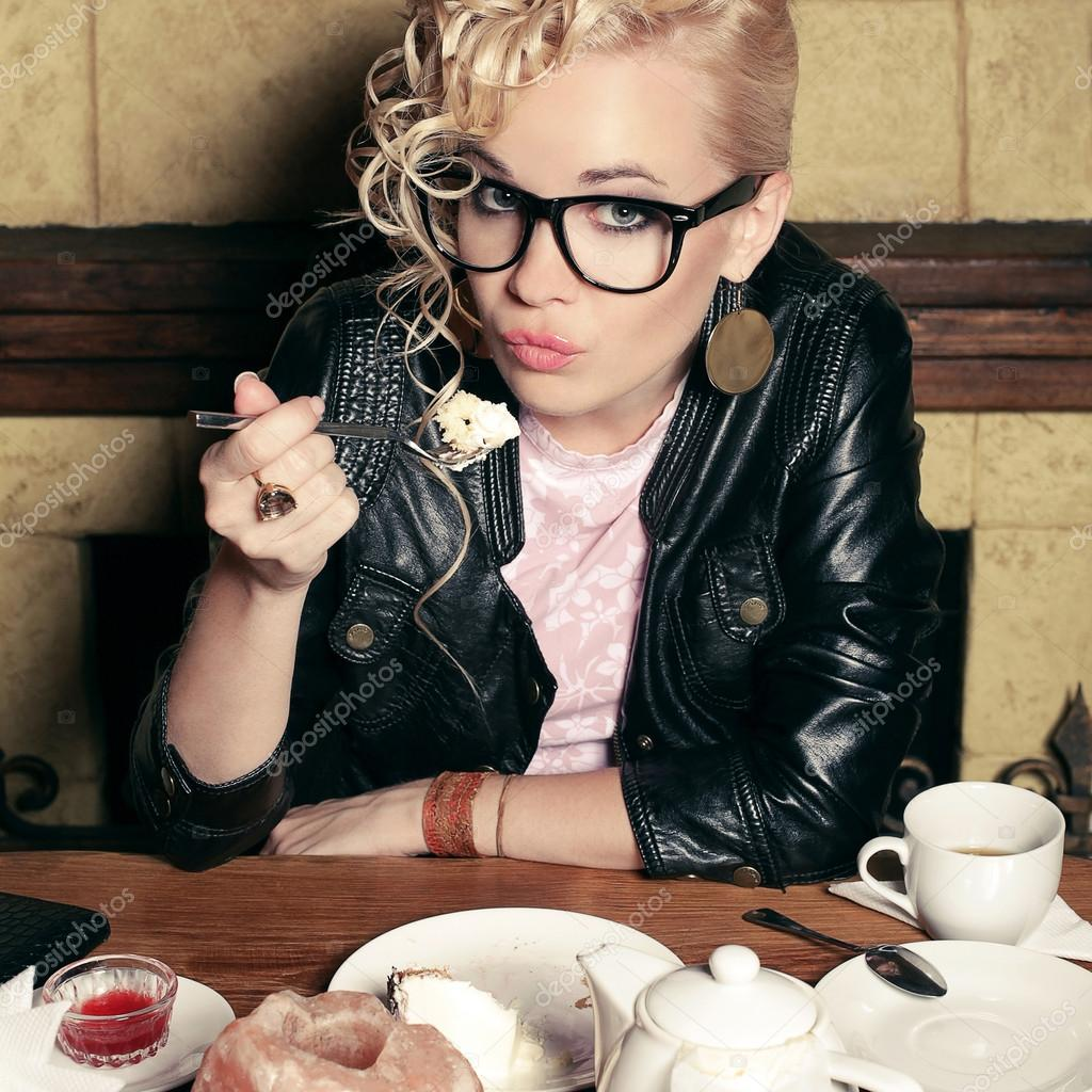 Funny stylish blonde girl with great hairdo in glasses and black ...