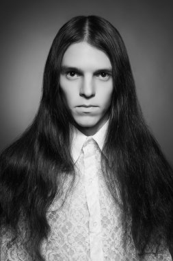 Old fashioned (vintage, retro style) portrait of a long-haired m