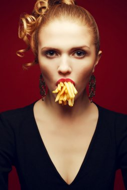 Unhealthy eating. Junk food concept. Arty portrait of fashionabl
