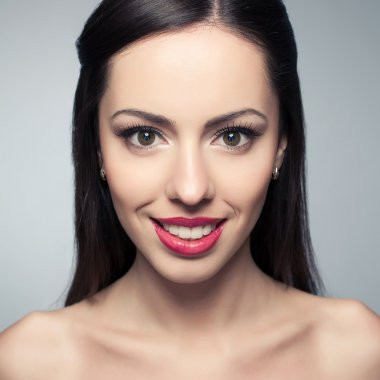Portrait of a beautiful young woman with great white shiny smile