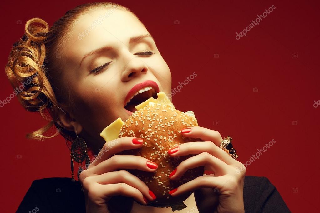 Unhealthy eating. Junk food concept. Guilty pleasure. Portrait o