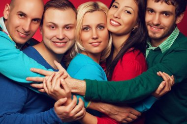 Happy people concept. Portrait of five stylish close friends hug