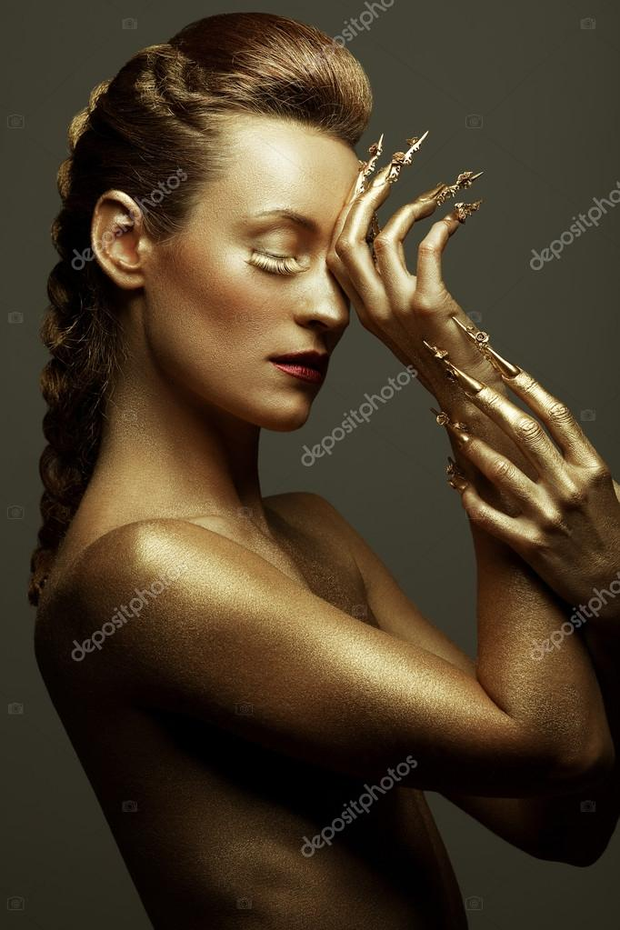 Golden statue of Valkyrie concept. Arty portrait of model with g