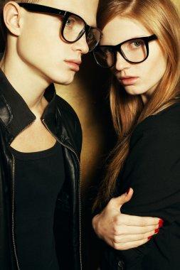 Eyewear concept. Family portrait of gorgeous blond fashion twins