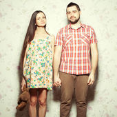 Stylish pregnancy concept: portrait of couple of hipsters (husba