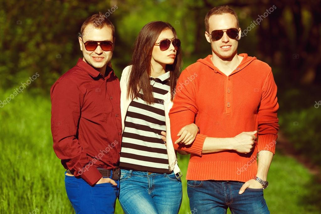 Hipster people concept. Portrait of fashionable friends in park