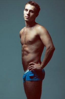 Male underwear fashion concept. Emotive portrait of young man in