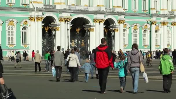 Tourists walking in Palace Square, St. Petersburg, Russia
