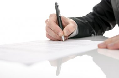 Business man signing a contract on a white table. With selective focus. stock vector
