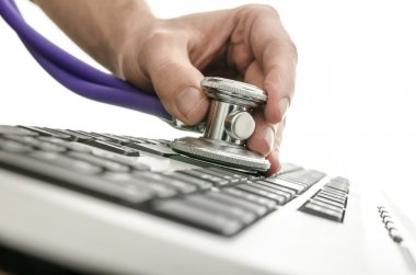 Testing a computer keyboard with stethoscope