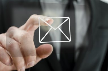 Businessman touching email icon