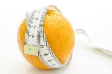Orange with measuring tape wrapped around it