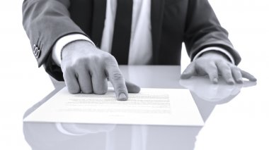Lawyer showing client to proof read a statement